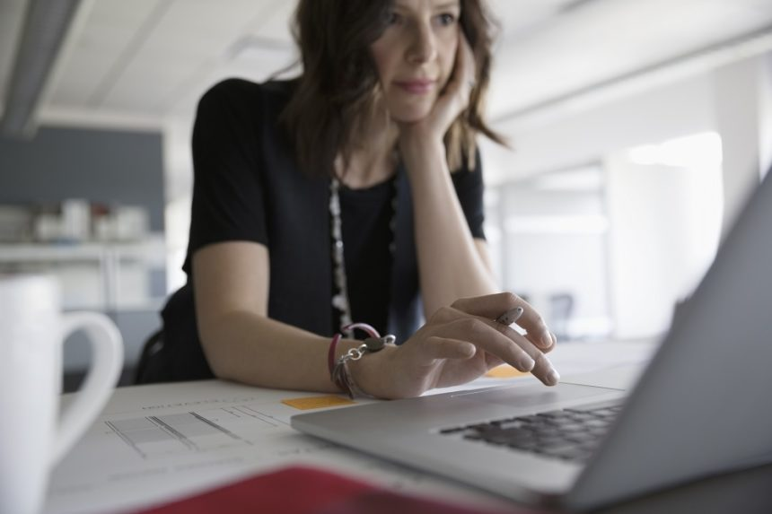 woman sitting on computer at desk