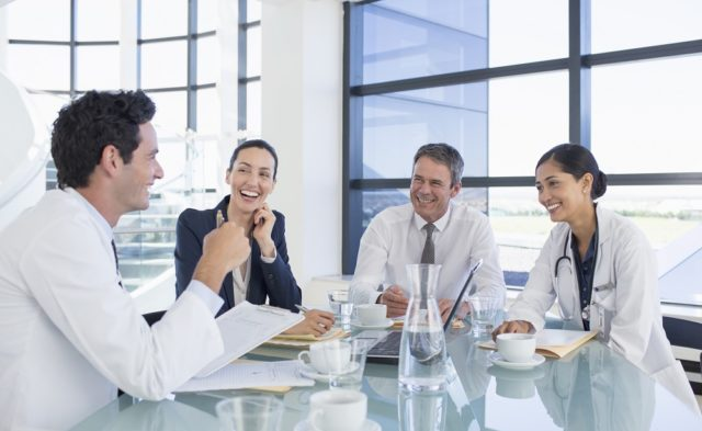 doctors meeting with business people