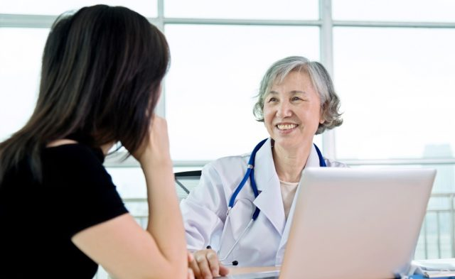 Female dr talking to patient