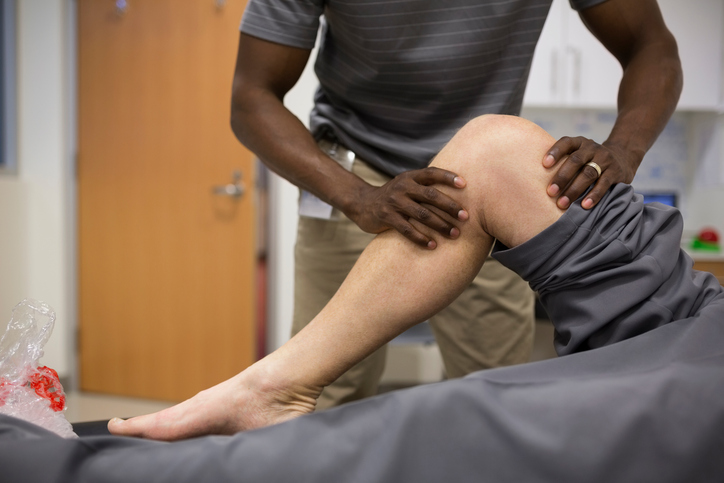 physical therapist stretching knee