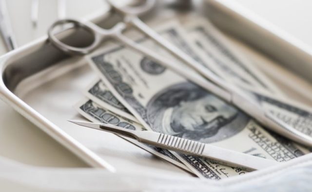 Surgical tools on top of money