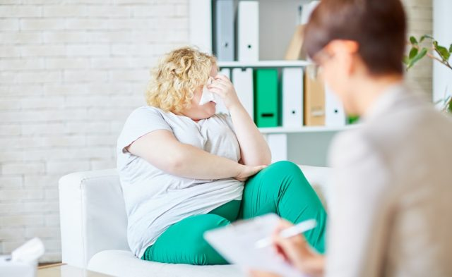 woman crying who is overweight
