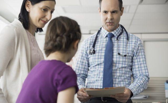 pediatrician talking to patient