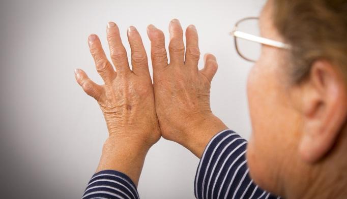Woman looking at hands