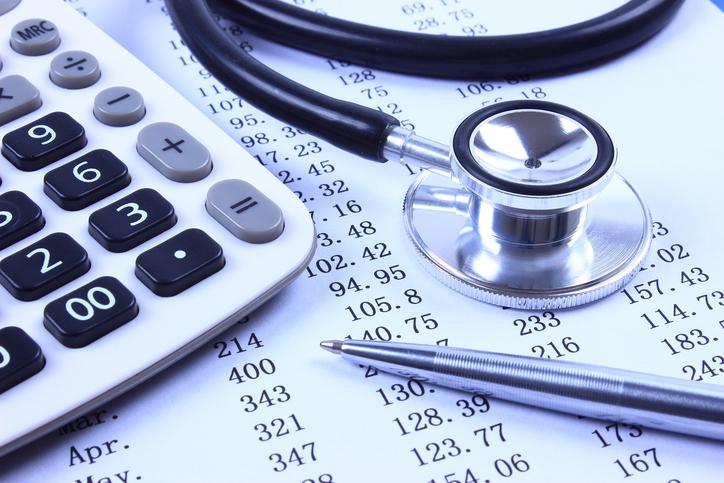stethoscope on top of financial statement