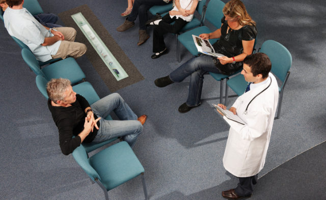 physician standing in a waiting room