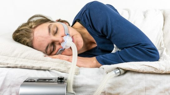 woman sleeping with CPAP