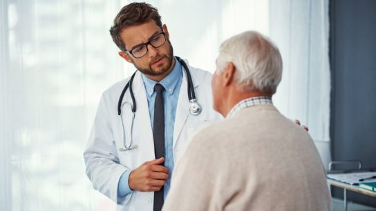 doctor talking to older patient