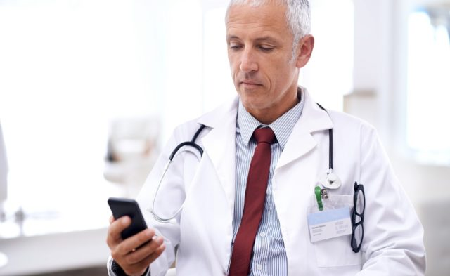 doctor texting