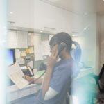 Nurse talking on telephone at nurses station