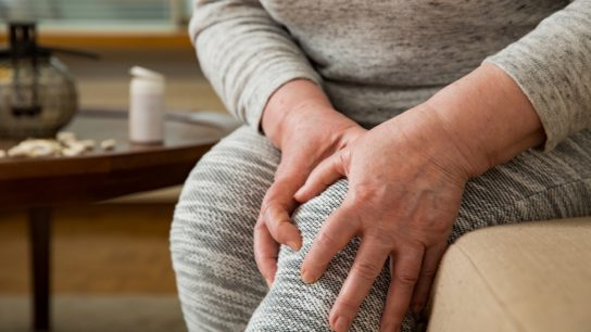 woman suffering from pain in knees