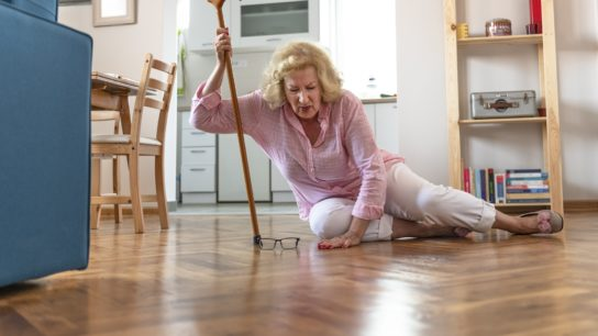 Older woman who has fallen on the floor