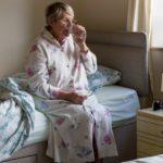 Older woman taking medications