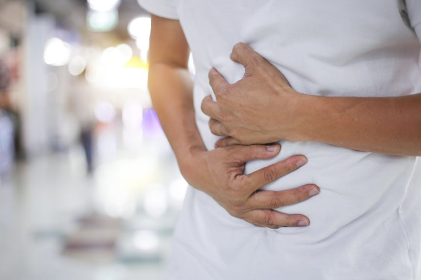 person with stomach pain
