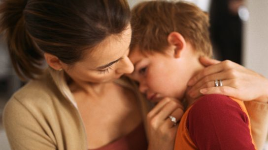 child in pain with parent
