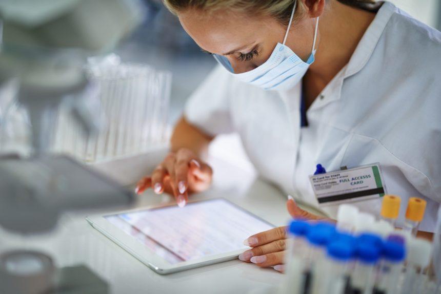 doctor using ipad, telemedicine, telehealth