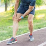 man with knee pain while exercising, physical activity
