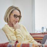 woman using cellphone for telemedicine, telehealth