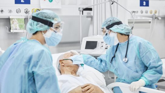 Doctors speaking with COVID19 patient in ICU
