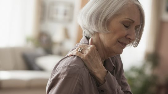 elderly woman with neck pain. fatigue