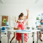 children wearing masks in the classroom social distancing