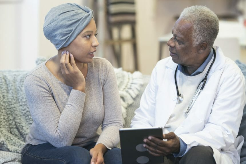 patient with cancer speaking to doctor