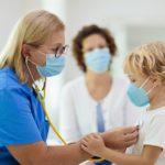 pediatrician examining pediatric patient