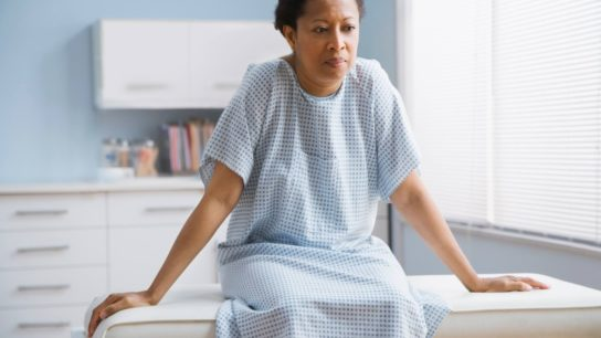 Black Female patient sitting on examination table