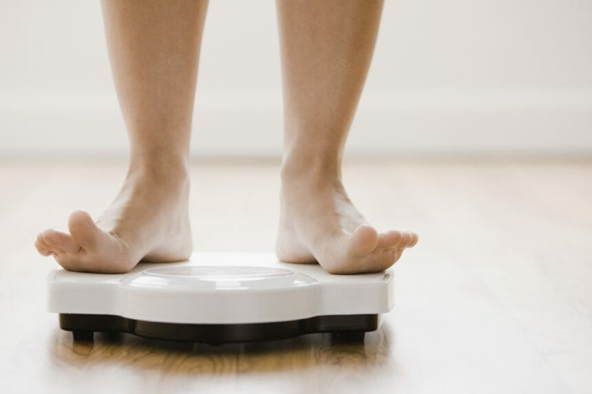 woman standing on scale, weight BMI