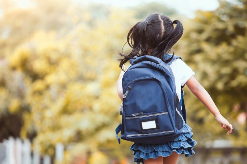girl with backpack on her way to school