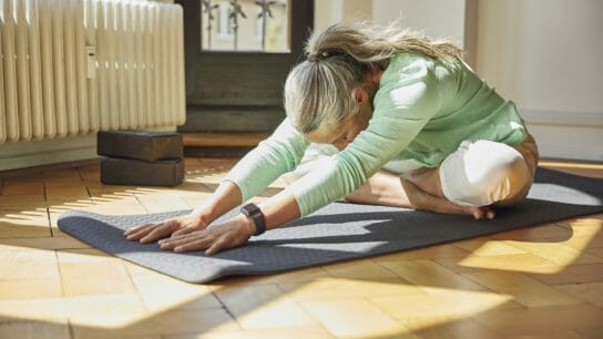 older woman, home exercise, yoga, stretching