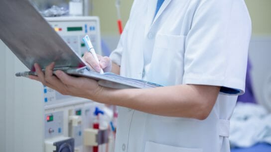 nurse checking clinical charts of patient, dialysis